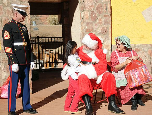 Santa talks with a little girl at a Toys for Tots giveaway at the Havasupai village on the floor of the Grand Canyon.