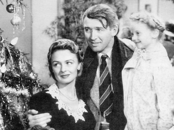 "Screenshot of ""It's a Wonderful Life"" with Donna Reed, Jimmy Stewart and Karolyn Grimes (as Zuzu)."