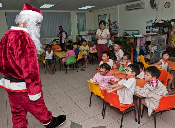Santa greets children in Singapore.