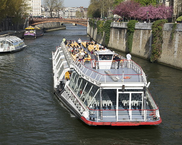 Bateau-Mouche (boat tours) on Seine River in Paris near the Notre-Dame Cathedral