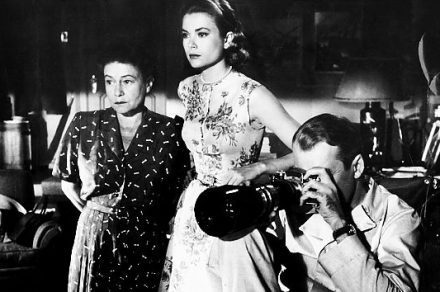 Thelma Ritter (as Stella), Grace Kelly and James Stewart focus in on Raymond Burr (as Lars Thorwald)