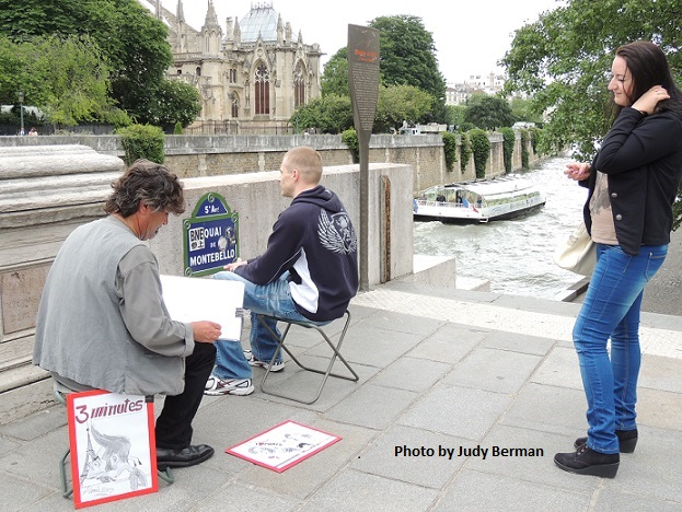 An artist drawing a caricature along the Seine River