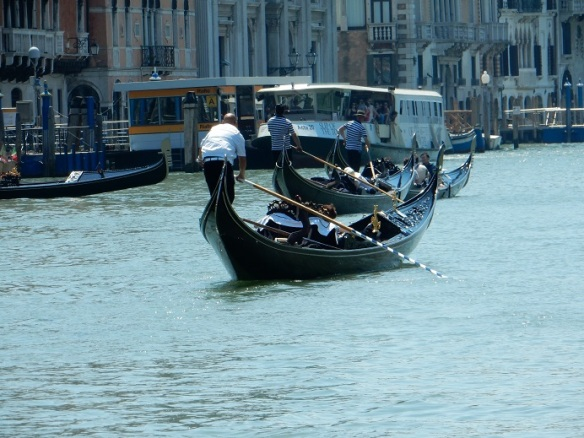 Venice - gondoliers and vaporetto on the Grand Canal