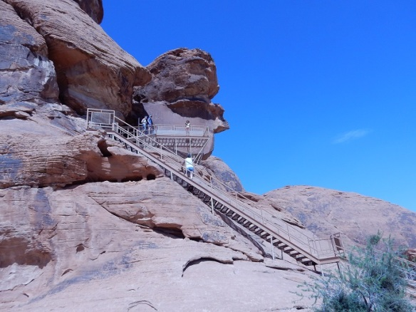 climbing steps to see petroglyphs (writings in the desert)